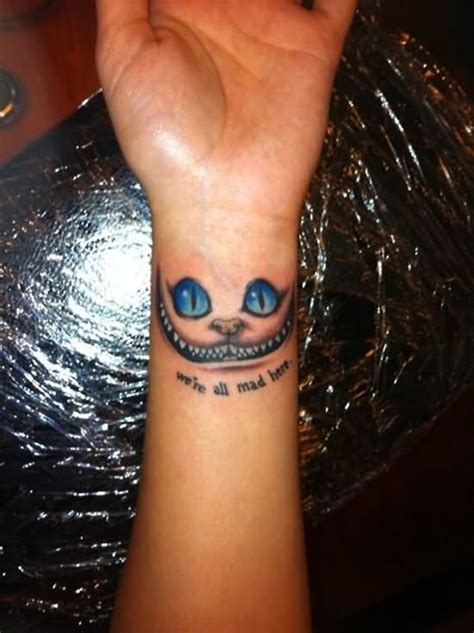 we re all mad here tattoos we are all mad here cheshire cat on left wrist
