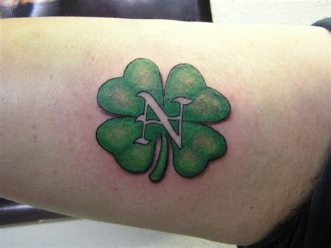 leaf design tattoos four leaf clover tattoos designs ideas and meaning