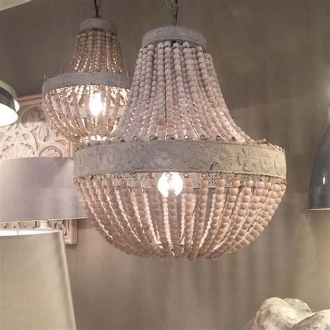 old white wooden bead chandelier with distressed metal