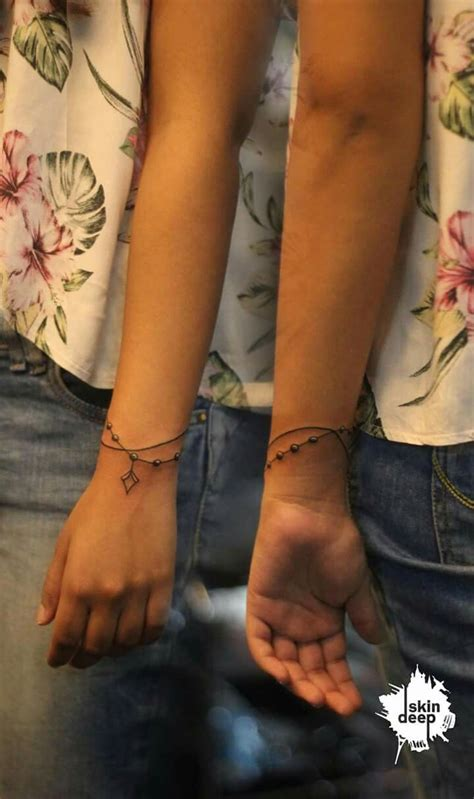 bracelet cross wrist tattoos best 25 wrist bracelet tattoos ideas on