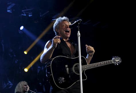 bon jovi d jon bon jovi says his wife saved him after he fell into a