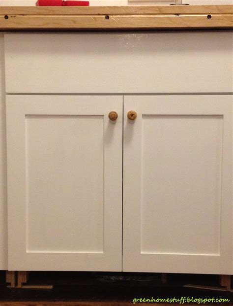 where to place knobs on kitchen cabinet doors green home stuff repurposed chagne cork cabinet knobs