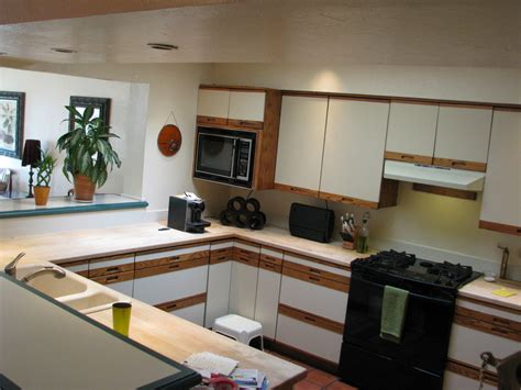 reface laminate kitchen cabinets refaced kitchen cabinets for an open floorplan home