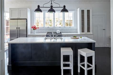 White Backsplash Kitchen Is The Black Cabinetry Domino Dulux