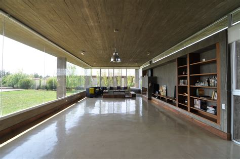 Exposed Concrete Ceiling by Km House Designed By Estudio Pablo Gagliardo Keribrownhomes