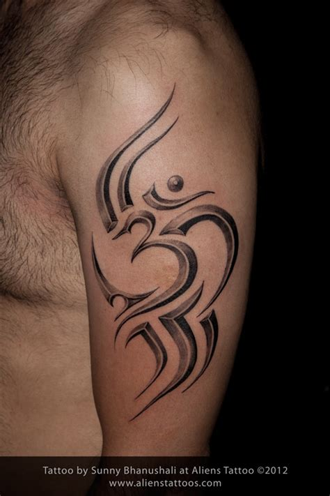 tribal om tattoo design and inked by sunny at aliens