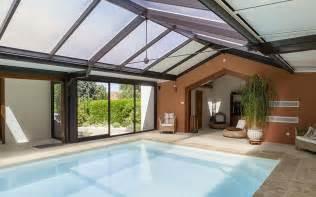 Impressionnant Grand Abri De Jardin #5: véranda-abri-piscine-toiture-plate-aluminium-espace-verandas-grand-ouest-maconnerie2.jpg