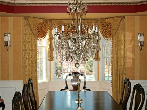 formal window treatments spaces traditional with artistic an ornate crystal and gold chandelier adds sparkle to this