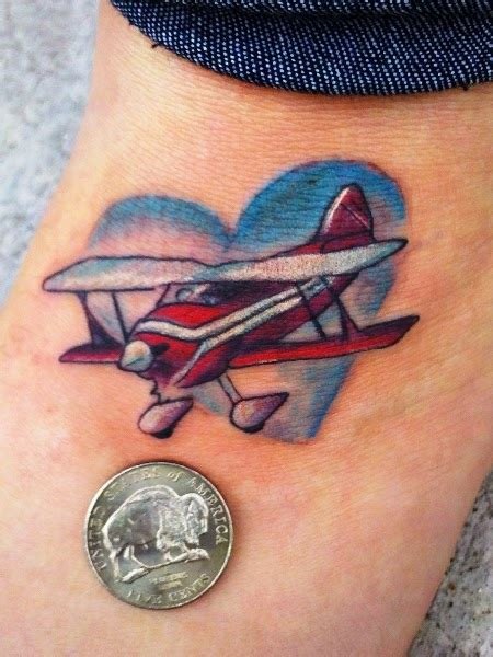 plane tattoo designs unique shape on foot