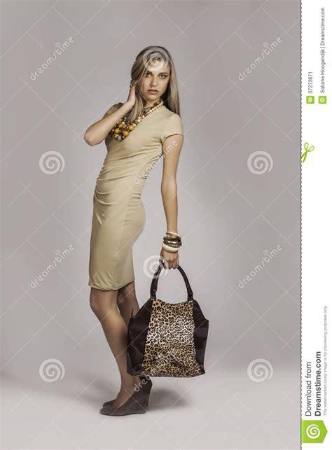 blonde girl  african safari styled fashion holding handbag stock image image