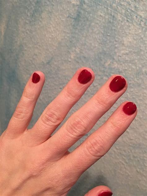 red fingernails painted  photo  pixabay
