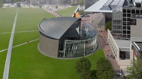 van gogh museum amsterdam zonnebloemen indrukwekkende glazen entree van gogh museum glas in beeld