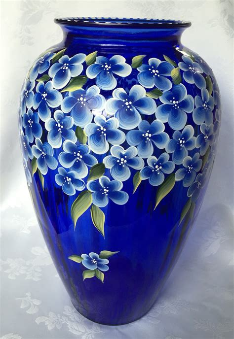 Blue Vase With Flowers by Painted Cobalt Blue Vase With Blue Flowers And Green