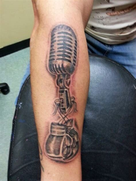 cj tattoo microphone and boxing gloves black and gray