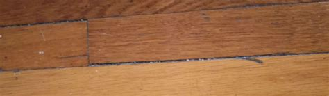 how to fill holes in hardwood floor large medium and