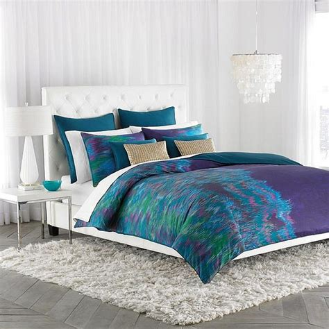 blue bedding decorating the bedroom with green blue and purple