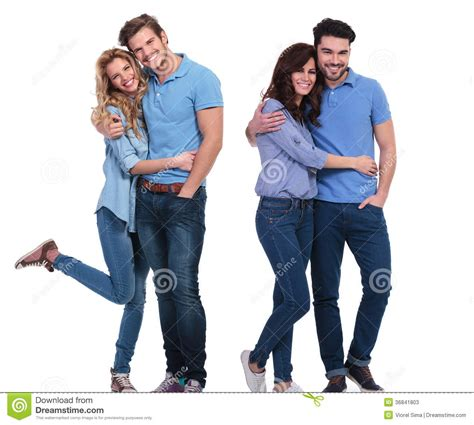 Two Couples Two Happy Couples Of Casual Standing Embraced