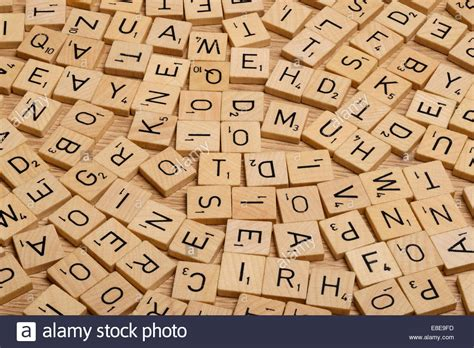 scrabble using all letters jumble of wooden scrabble letter tiles stock photo