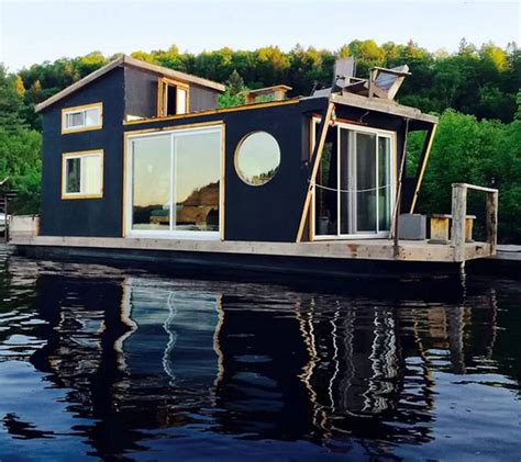 mini house boat winterproofed houseboat with a rooftop deck is a tiny