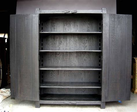 modern armoires and wardrobes custom large primitive modern armoire cabinet wardrobe in ebony finish for sale at 1stdibs
