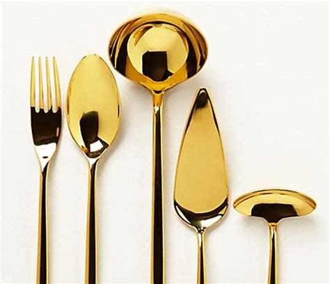 gold plated gwyneth paltrow suggests gold plated kitchen tools as