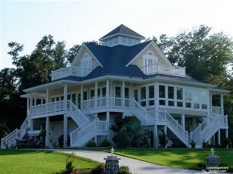 a cottage house ranch style house with wrap around porch