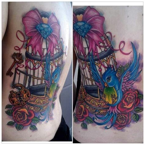 diamond key tattoo bird in cage with roses and key tattoo bow and diamond