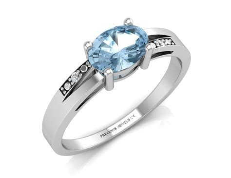 9ct white gold oval shape blue topaz engagement