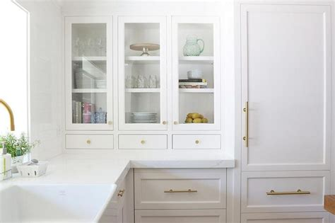 white and gold kitchen features white cabinets adorned 35 best images about cabinet hardware on drawer pulls brass drawer pulls and satin