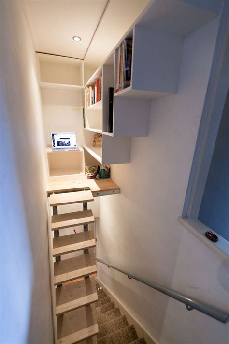 make use of the dead space above the existing stairs the stairs raise up when the library isn