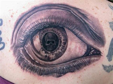 eye tattoo with skull skull in eyeball tattoo by phil young tattoos