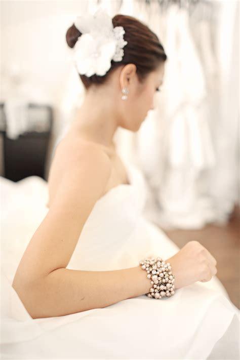 elegant wedding buns gorgeous bridal updo elegant bun with feather flower
