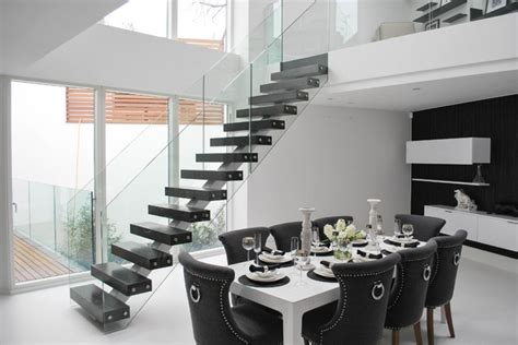 Elegant Middle Spine Staircase In Black And White Modern Modern Dining Room Ls