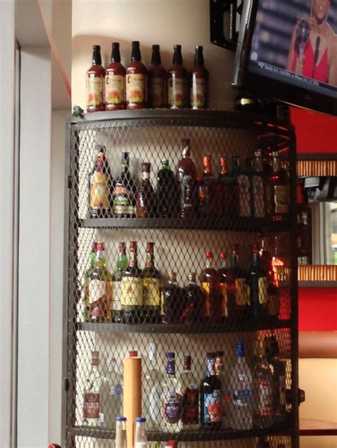 Displaying Books On The Floor - corner liquor display shelf made of iron liquor store