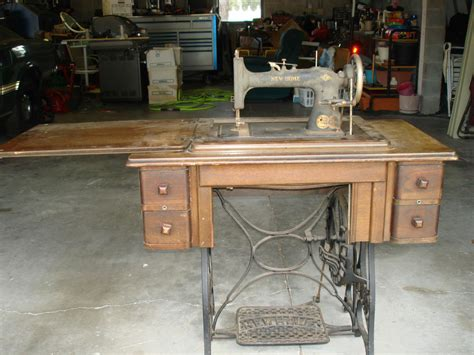 antique new home treadle sewing machine in wood cabinet 4