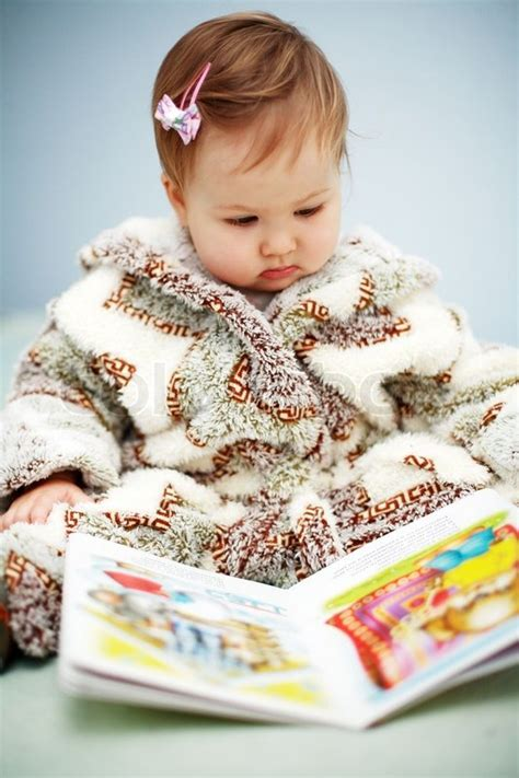 baby picture book portrait of baby reading a picture book stock photo