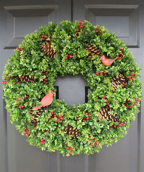 christmas faux boxwood wreath with red cardinals by