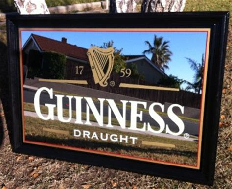 large guinness draught beer  bar mirror pub