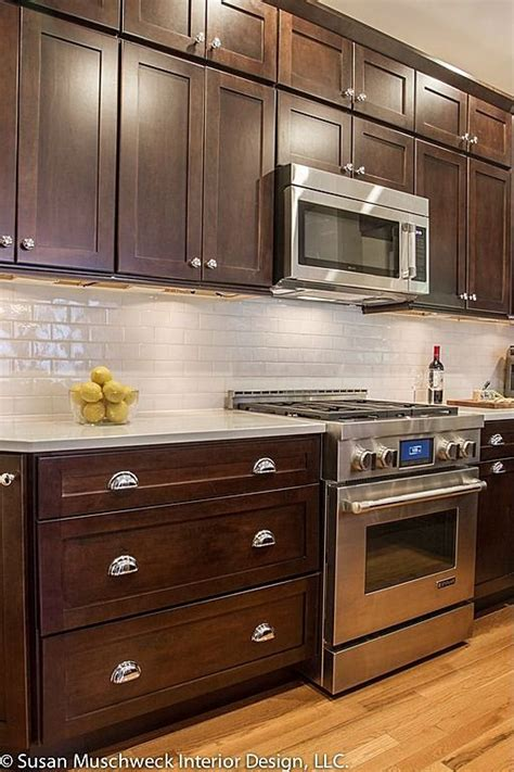 white tile backsplash dark cabinets like the gas stove oven i also like the light floors with