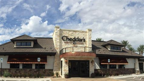 darden restaurants to buy cheddar s scratch kitchen