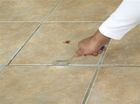 how to remove old grout from bathroom tiles how to replace a broken floor tile how tos diy