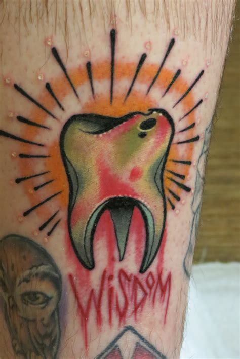 tooth tattoo small molar on ankle