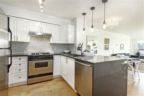 Light Colored Kitchen Cabinets small penthouse apartment in vancouver with a space saving