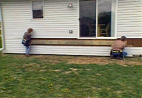 attaching deck to house with siding hometime how to decks attaching ledger board and footing layout