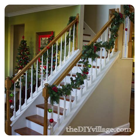 garland for stair banister christmas banister garland the diy village