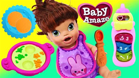 attack doll with bottle baby alive doll plays with the vtech baby amaze mealtime