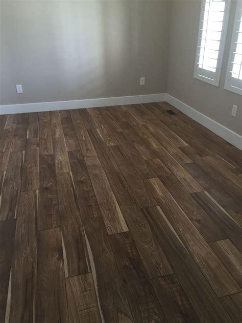 Real hand sawn hickory hardwood flooring? Nope. Just
