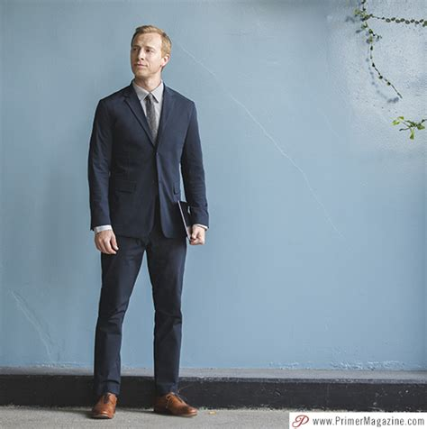 if i wear a navy suit brown shoes light blue shirt and a live action getup suit up business wear that works as