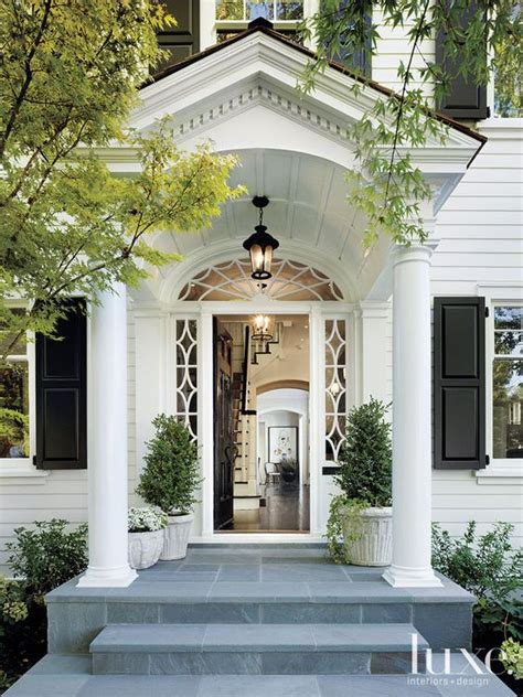 white dutch colonial revival entry luxe interiors updating a dated colonial exterior migonis home