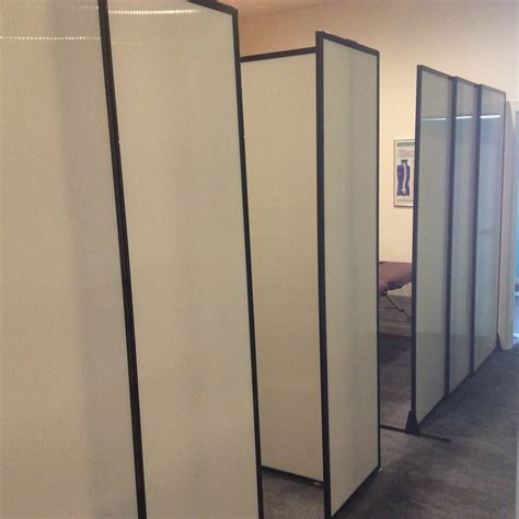 room partitions using sliding office partitions to create cubicles for